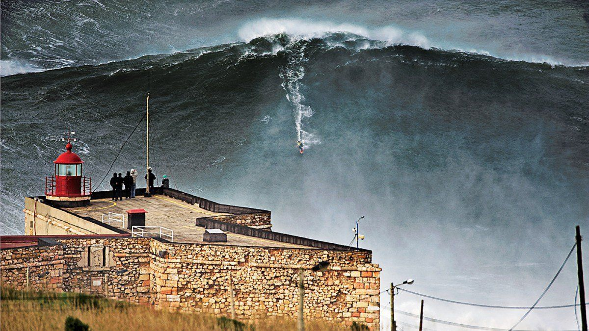 1 down the line riding the huge wave of Nazare