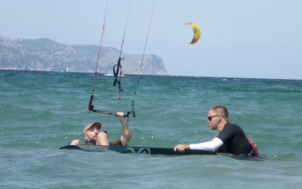 Rich's firm but friendly hand brings the kiteboard closer