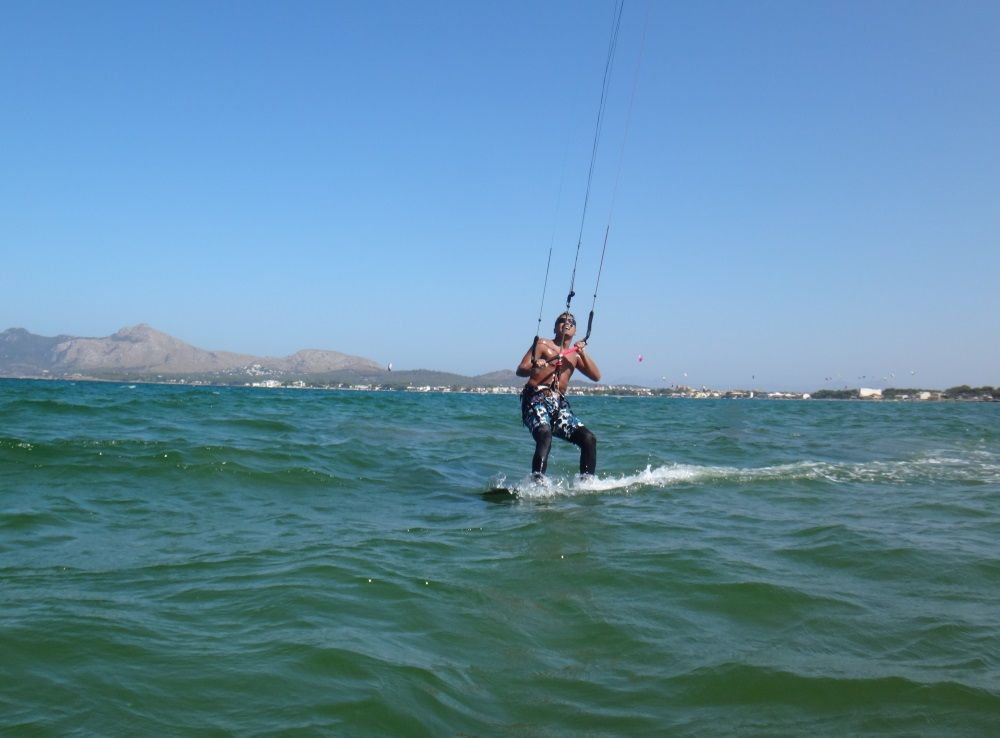 24-Oh-there-is-Cris-with-his-camera-let-me-surprise-him-kitesurfing-school-mallorca